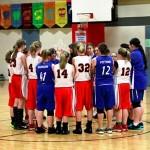 JV Girls & Bethel Christian praying before playing their game